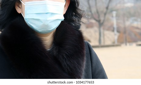 Woman with a mask to protect against fine dust.