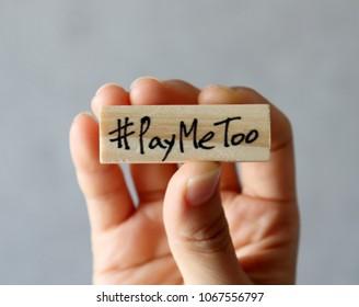 #PayMeToomovementconcept.Handholdingawoodenblockwith#PayMeToo