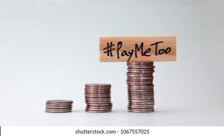 #PayMeToomovementconcept.Ablockofwoodwitha#PayMetoowrittenonpileofcoins.