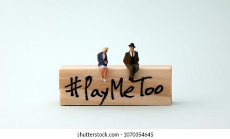 Woodenblockwritten#PayMeToo. Anewsocialmovetobridgethegenderwagegap.