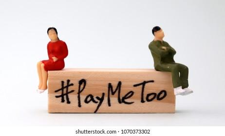 Woodenblockwritten#PayMeToo. Anewsocialmovementontherighttoequalpayformenandwomen.
