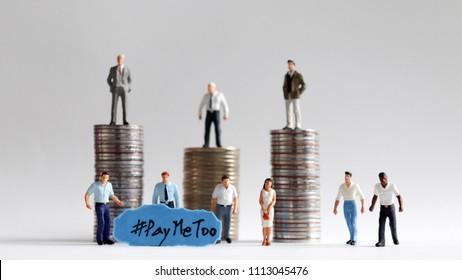 #PayMeTooassocialnewmovement. Thestackofcoinswithminiaturepeople.