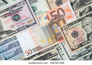 Banknotes of dollars  different denominations and 50 euro. Business abstract background