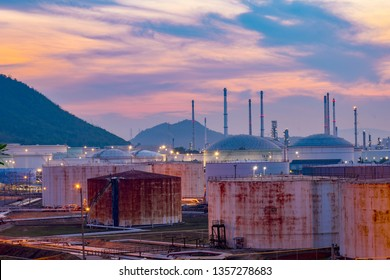 Natural gas storage tank and petrochemical plant at sunrise