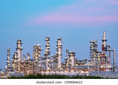 Oil refinery at blue twiligth sky background