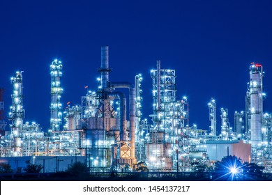 Oil​ refinery​ and​ petrochemical​ plant​ ​industry, natural​ ​gas​ ​storage​ ​tank​ pipelines​ ​street​ with​ ​blue​ ​night​ sky​ ​background.