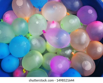 The many water ballons colourful Floating in the water use for children play funny and background pattern and abstract water ballons