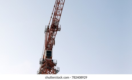 Construction site with cranes on blue sky background.