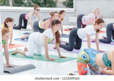 01 JULY 2018, UFA, RUSSIA: Group of Attractive young sport girls training and doing yoga together