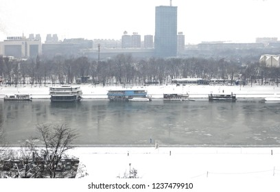 01.01.2018. Belgrade, Serbia. Cityscape with snowfall seen from Kalemegdan hill completely covered by snow in winter blizzard with Sava river in background .