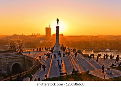 01.01.2018.Sunset light on Danube river, viktor statue and silhouettes of people in fortress Kalemegdan in Belgrade Serbia