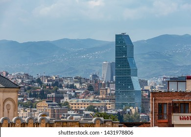 01/05/2019 Tbilisi, Georgia, view of the glass tower of the Biltmore Hotel against the background of the city and the blue sky
