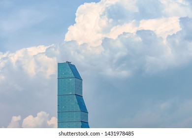 01/05/2019 Tbilisi, Georgia, view on the glass tower of the Biltmore Hotel on the background of blue sky and clouds