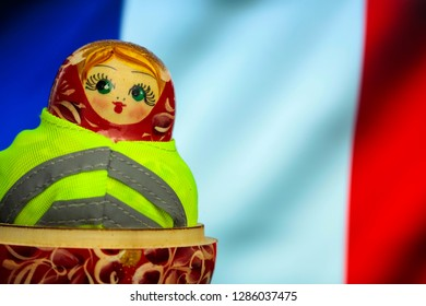 01/16/2019 Yellow vest protest dressed Russian doll with french flag in background - Editorial Image