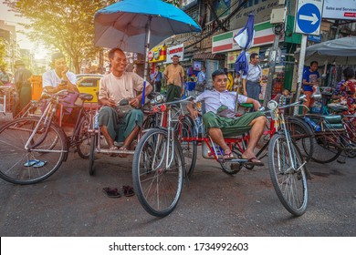 01/21/2020 Myanmar (Burma) Yangon, taxi drivers resting waiting for new customers on their tricycle taxi also known as Saika. A popular form of transportation among the local poor