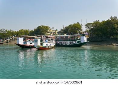 01/22/2014, West Bengal : A tourist motorboat moored at riverbanks of Sundarbans river delta, West Bengal. Shot at Sajnekhali.