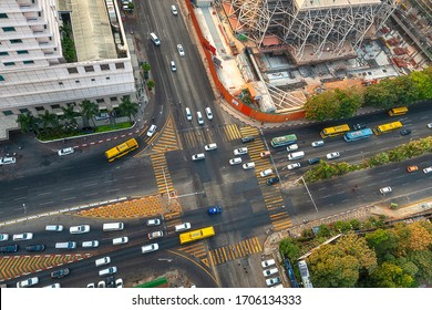 01/22/2020 Yangon, Myanmar (Burma), Aerial shot, view from the drone on the downtovn of Yangon with traffic intersection at sunset pop colors. Yangon - the ancient capital of Burma