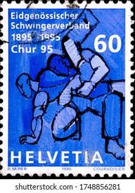 02 08 2020 Divnoe Stavropol Territory Russia postage stamp Switzerland 1995 Anniversaries Federal Schwinger Association 1895-1995 Schwingen two fighters