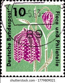 02 09 2020 Divnoe Stavropol Territory Russia postage stamp Germany 1963 Flora and Philately Exhibition, Hamburg Stampexhibition Flora and philately Fritillaria meleagris pink flowers on a green