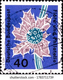 02 09 2020 Divnoe Stavropol Territory Russia postage stamp Germany 1963 Flora and Philately Exhibition, Hamburg flower on blue background