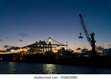 02 March 2021 Russia, Novorossiysk. International trade port with a crane for sea containers in the evening.