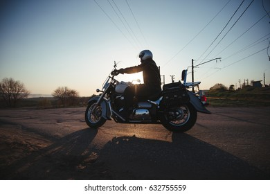 02 may 2017 - Russia - Samara - White man rides a classic motorcycle against the sunset