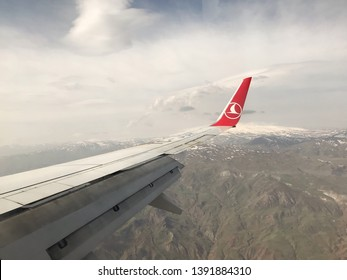 02 MAY 2019 Igdir -Turkey: Turkish Airlines airplane wing let at the sky