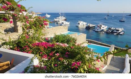 02 September 2015: Photo from famous Mykonos blue resort overlooking Psarou beach, Mykonos island, Cyclades, Greece