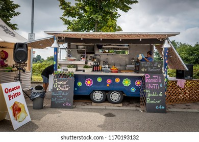 02 September 2018 - Giussano (Italy) - Trucks and vehicles used for the preparation and sale of street food, with typical Italian specialties.