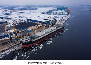 02-02-2021 Riga, Latvia. Logistics and transportation of International Container Cargo ship with tugboat in the ocean, Freight Transportation, Shipping.