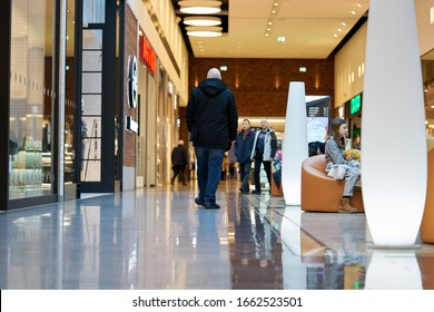 02-03-2020 Riga, Latvia Wide hall and buyers in trading center with shops on both sides.