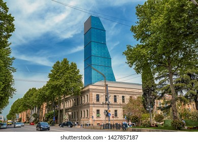 02/05/2019 Georgia, Tbilisi, Georgia, Tbilisi, view of the glass tower of the Biltmore Hotel in the city center and against the background of the blue sky