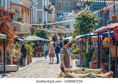 02/05/2019 Tbilisi, Georgia, A cozy street of old Tbilisi with a variety of restaurants, cafes and bars on it, and walking tourists