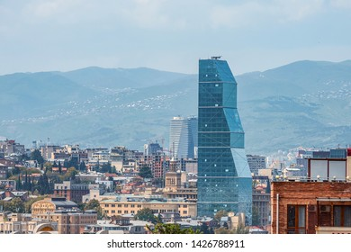 02/05/2019 Tbilisi, Georgia, Georgia, Tbilisi, view of the glass tower of the Biltmore Hotel against the background of the city and the blue sky