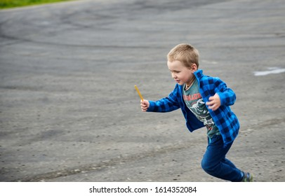 02-08-2017 Riga, Latvia. little boy runs in a summer park