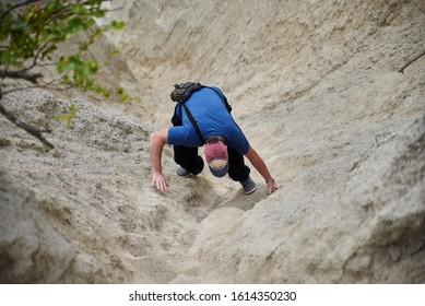 02-08-2017 Riga, Latvia. Rock climber climbing up a cliff