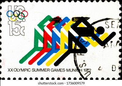 02.09.2020 Divnoe Stavropol Territory Russia Postage Stamp United States 1972 Summer Olympic Games Munich, Germany Running and Olympic Rings Character Figures Runners