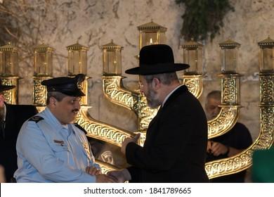 02-12-2018. jerusaelm-israel. Chief Rabbi of Israel Rabbi David Lau lighting Hanukkah candles at the Western Wall next to Police Chief Roni Alshikh