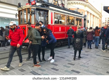 02/18/2019- Beyoglu, Istanbul, Turkey. Tram in Istiklal  street . People taking photos in front of the historic tram.
