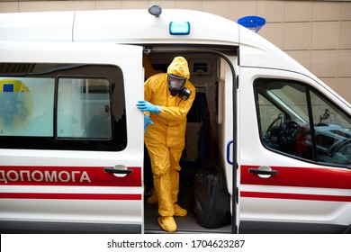 02/28/2020 Ukraine. Kyiv. Teachings. Doctors transport the patient for coronavirus to an infectious diseases hospital. Doctors in protective suits. Patient in a protective mask