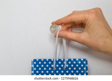 0.25 Turkish lira and plastic bag on the background. hand hold money with grocery sack