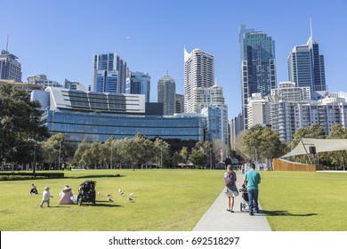 03 AUG 2017 - SYDNEY, AUSTRALIA - Darling Harbour area that backs onto Central Business District of Sydney City, people enjoy the green space just outside of the CBD