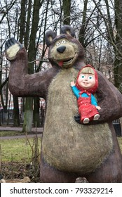 """03 Jan 2018 - Klimovsk, Moscow region. The characters of the popular Russian cartoon """"Masha and the bear"""". Sculpture in the city Park."""