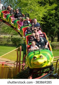 03 May 2013 Paultons Park, England. Parents and Children enjoy riding on a Family roller-coaster