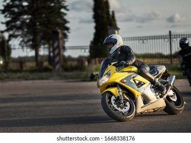 03-09-2019 Riga, Latvia A beautiful biker girl sitting on her superbike
