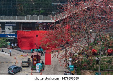 03/13/2019 - Haryana, India: Aerial shot of a veiled restaurant building in an open mall. Hong's kitchen asian restaurant by Jubilant Foodworks, with grand opening inauguration hidden with red cloth.