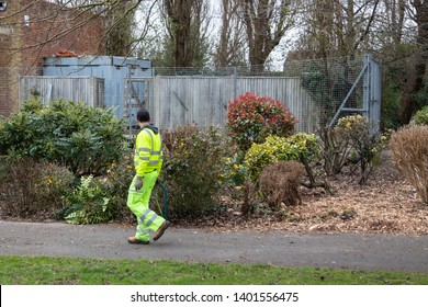 03/18/19 Portsmouth, Hampshire, UK a Council gardener gardening in the local park wearing hi visibility clothing