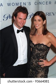 03DEC97:  Supermodel CINDY CRAWFORD & boyfriend RANDY GERBER at the Fire & Ice Ball at Paramount Studios, Hollywood, to benefit the Revlon/UCLA Women's Cancer Research Program.
