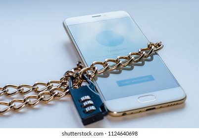04/13/2018, Moscow, Russia. Tagansky district court decided to block the messenger's telegrams. The symbol of the prohibition of freedom of speech and access to software: smartphone chained in a chain