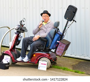 04.14.2018 Whitstable, Kent, UK. Disabled man busking, Whitstable market, Kent